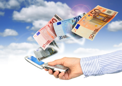 Mobile phone and euro money.