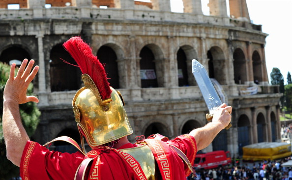 A man dressed as a Roman centurion and w