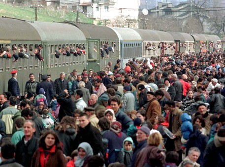 PEOPLE WAIT FOR A TRAIN IN KOSOVO