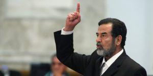 Former Iraqi president Saddam Hussein reacts as the verdict is delivered during his trial held under tight security in Baghdad's heavily fortified Green Zone, Sunday Nov. 5, 2006. Iraq's High Tribunal on Sunday found Saddam Hussein guilty of crimes against humanity and sentence him to die by hanging. (AP Photo/Scott Nelson, Pool)