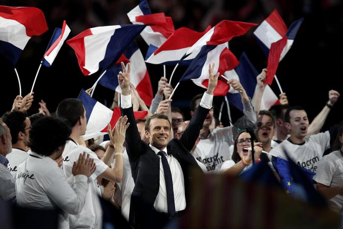epa05946110  (FILE) A file picture dated 17 April 2017 shows French presidential election candidate from the centrist 'En Marche!' (Onward!) political party, Emmanuel Macron (C) gesturing toward the audience after making his speech, during his political campaign rally at the AccorHotels Arena, in Paris, France. Emmanuel Macron's campaign announced on 05 May 2017 it has been the victim of hacking after nine gigabyte of emails purporting to belong to the campaign were posted online.  EPA/YOAN VALAT