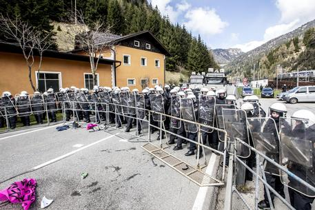 epa06066277 (FILE) - Austrian riot police line up to face protesters (not pictured) during a rally against the Austrian government's planned re-introduction of border controls at the Brenner Pass, Austria, 24 April 2016, (reissued 04 July 2017). Media reports on 04 July 2017 state that Austrian Defence Minister Hans Peter Doskozil has said that troops could go to the Brenner Pass, the border in Tyrol between Austria and Italy and four Pandur armoured personnel carriers had been sent to  Tyrol with 750 troops on readiness to move in an effort to stop any large numbers of migrants croassing the border.  EPA/JAN HETFLEISCH
