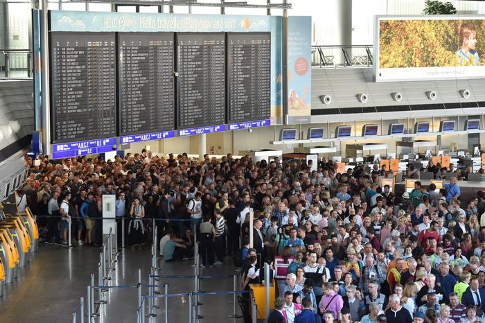 epa05516430 Thousands of people stream out of Terminal 1 after the evacuation announcement at the Frankfurt airport in Frankfurt on the Main, Germany, 31 August 2016. In the early hours of 31 August, parts of Terminal 1 had to be evacuated because a person had reached the security area of the airport without usual security checks, according to airport operator Fraport.  EPA/BORIS ROESSLER