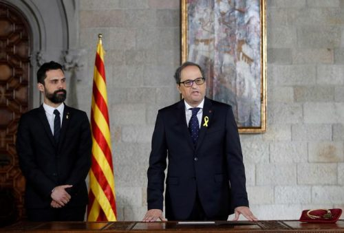 New Catalan President Quim Torra, right, talks during a swearing in ceremony next to Catalan Parliament President Roger Torrent at the Catalonia's Parliament in Barcelona, Thursday, May 17, 2018. Torra formally took office at a ceremony in the Catalan capital Barcelona on Thursday. He was elected by the Catalan parliaments secessionist lawmakers on Monday. (Alberto Estevez, Pool via AP)