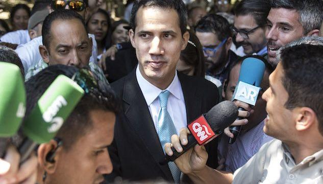 January 31, 2019 - Caracas, Venezuela - Opposition leader and self-proclaimed ''acting president'' Juan Guaido (L) greets a supporter as he arrives at Venezuela's Central University (UCV) in Caracas to present his government's plan on January 31, 2019. Venezuela's self-proclaimed acting president Juan Guaido ruled out the possibility of civil war in his country, saying the overwhelming majority of his compatriots wanted Nicolas Maduro to step down. In an interview to Spain's El Pais newspaper published Thursday, Guaido repeated an appeal to Venezuela's armed forces to take his side. (Credit Image: � Elyxandro Cegarra/ZUMA Wire)